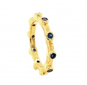 14k gold sea grass eternity band with sapphires